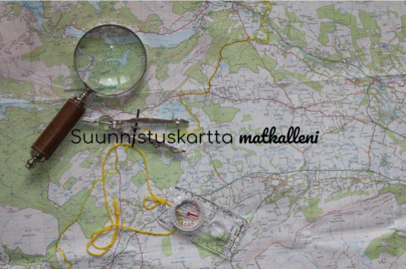 Suunnistuskartta matkalleni - kuva kartasta ja suurennuslasista